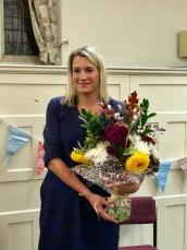 Jess holding Paula's handmade bouquet